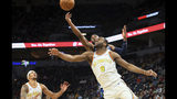 Minnesota Timberwolves' Josh Okogie, top right, of Nigeria, knocks the ball away from Golden State Warriors' Alec Burks (8) in the first half of an NBA basketball game Friday, Nov 8, 2019, in Minneapolis. (AP Photo/Jim Mone)