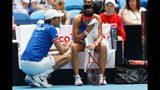 French Captain Julien Benneteau consoles Caroline Garcia as she suffered a defeat by Australia's Ashleigh Barty during their Fed Cup tennis final in Perth, Australia, Saturday, Nov. 9, 2019. (AP Photo/Trevor Collens)