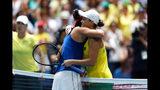 Australia's Ashleigh Barty hugs France's Caroline Garcia at the net after their Fed Cup tennis final in Perth, Australia, Saturday, Nov. 9, 2019. (AP Photo/Trevor Collens)