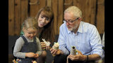 Labour leader Jeremy Corbyn and Shadow Education Secretary Angela Rayner during a visit to the Scrap Creative Reuse Arts Project while on the General Election campaign trail in Leeds, England, Saturday, Nov. 9, 2019. British political leaders are swapping blame over floods that have drenched parts of England as the deluge becomes an issue in the campaign for the Dec. 12 election. (Nigel Roddis/PA via AP)