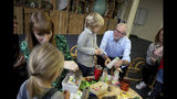Labour leader Jeremy Corbyn during a visit to the Scrap Creative Reuse Arts Project while on the General Election campaign trail in Leeds, England, Saturday, Nov. 9, 2019. British political leaders are swapping blame over floods that have drenched parts of England as the deluge becomes an issue in the campaign for the Dec. 12 election. (Nigel Roddis/PA via AP)