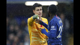 Chelseas' goalkeeper Kepa Arrizabalaga, left, talks to his teammate Fikayo Tomori during their English Premier League soccer match between Chelsea and Crystal Palace at Stamford Bridge stadium in London, Saturday, Nov. 9, 2019. (AP Photo/Alastair Grant)