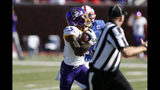 East Carolina's Jsi Hatfield, center, runs after a catch for a touchdown during the first half of an NCAA college football game against SMU, Saturday, Nov. 9, 2019, in Dallas. (AP Photo/Roger Steinman)