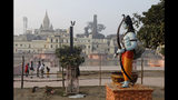 A statue of Hindu god Rama stands beside the River Sarayu in Ayodhya, India , Saturday, Nov. 9, 2019. India's security forces were on high alert ahead of the Supreme Court's verdict Saturday in a decades-old land title dispute between Muslims and Hindus over plans to build a Hindu temple on a site where Hindu hard-liners demolished a 16th century mosque in 1992, sparking deadly religious riots. (AP Photo/Rajesh Kumar Singh)