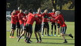 Toronto FC midfielder Michael Bradley, right, runs towards teammates as they share a lighthearted moment during a training session, Friday, Nov. 8, 2019, in Tukwila, Wash. Toronto FC will face the Seattle Sounders Sunday in the MLS Cup soccer match at CenturyLink Field in Seattle, the third time the two teams will have met for the MLS championship. (AP Photo/Ted S. Warren)