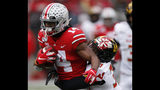 Maryland defensive back Lavonte Gater, right, tackles Ohio State receiver K.J. Hill during the first half of an NCAA college football game, Saturday, Nov. 9, 2019, in Columbus, Ohio. (AP Photo/Jay LaPrete)