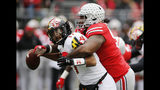 Ohio State defensive lineman Davon Hamilton, right, sacks Maryland quarterback Josh Jackson during the first half of an NCAA college football game, Saturday, Nov. 9, 2019, in Columbus, Ohio. (AP Photo/Jay LaPrete)