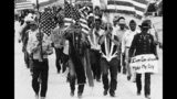"""In this July 8, 1986, file photo, World War II Navajo veterans and supporters march through the reservation in a show of solidarity against giving up any of their land to the Hopis in Arizona. """"The Warrior Tradition,"""" a new film set to air on most PBS stations Monday, Nov. 11, 2019, examines the history of Native Americans in the U.S. military since World War I. (AP Photo/Jeff Robbins, File)"""