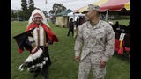"""In this June 15, 2012, file photo, Blas Preciado, left, a Vietnam War veteran of the Kiowa tribe, talks with Marine Cpl. Frank Tartsah, right, also of the Kiowa tribe, during a Native American blessing for veteran and active-duty servicemen in Camp Pendleton, Calif. """"The Warrior Tradition,"""" a new film set to air on most PBS stations Monday, Nov. 11, 2019, examines the history of Native Americans in the U.S. military since World War I. (AP Photo/Gregory Bull, File)"""