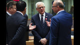 Polish Foreign Minister Jacek Czaputowicz, second right, talks to Lithuanian Foreign Minister Linas Linkevicius, left, Malta's Foreign Minister Carmelo Abela, second left, and Croatian Foreign Minister Gordan Grlic Radman during an European Foreign Affairs Ministers meeting at the Europa building in Brussels, Monday, Nov. 11, 2019. European Union foreign ministers are discussing ways to keep the Iran nuclear deal intact after the Islamic Republic began enrichment work at its Fordo enrichment facility. (AP Photo/Francisco Seco)