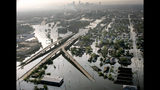 FILE - In a Aug. 30, 2005 file photo, floodwaters from Hurricane Katrina fill the streets near downtown New Orleans. The most destructive U.S. hurricanes are hitting three times more frequently than they did a century ago, a new study by a Danish research team said Monday, Nov. 11, 2019. (AP Photo/David J. Phillip, File)