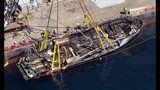 FILE - In this Sept. 12, 2019, file photo, the burned hull of the dive boat Conception is brought to the surface by a salvage team off Santa Cruz Island, Calif. The widow of Justin Dignam, one of the 34 people who died in the fire, has filed a lawsuit against the boat's owners, making it the first claim from one of the 34 victims' families. (Brian van der Brug/Los Angeles Times via AP, File)