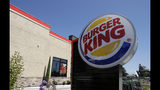 FILE - This April 25, 2019, file photo shows a Burger King in Redwood City, Calif. Burger King is introducing a plant-based burger in Europe. But it's not the Impossible Whopper that's been a hit with U.S. customers. Instead, a Dutch company called The Vegetarian Butcher will supply the new soy-based Rebel Whopper. It will go on sale Tuesday, Nov. 12, at 2,400 restaurants across Europe. (AP Photo/Jeff Chiu, File)