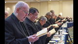 Monsignor Michael P. Morgan sings during an opening hymn at the start of the United States Conference of Catholic Bishops Fall General Assembly at the Baltimore Marriott Waterfront Monday, Nov. 11, 2019. (Jerry Jackson/The Baltimore Sun via AP)