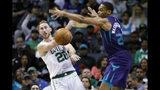Boston Celtics' Gordon Hayward (20) gets a pass off against Charlotte Hornets' P.J. Washington (25) during the second half of an NBA basketball game in Charlotte, N.C., Thursday, Nov. 7, 2019. The Celtics won 108-87. (AP Photo/Bob Leverone)