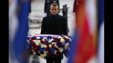 French President Emmanuel Macron lays a wreath of flowers at the Arc de Triomphe in Paris Monday Nov. 11, 2019 during commemorations marking the 101st anniversary of the 1918 armistice, ending World War I. (AP Photo/Francois Mori, Pool)