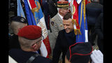 French President Emmanuel Macron with French Armies Chief of Staff General Francois Lecointre, behind, meets veterans under the Arc de Triomphe during commemorations marking the 101st anniversary of the 1918 armistice, ending World War I, Monday Nov. 11, 2019 in Paris (AP Photo/Francois Mori, Pool)