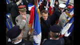 French President Emmanuel Macron with French Armies Chief of Staff General Francois Lecointre, left, meets veterans under the Arc de Triomphe during commemorations marking the 101st anniversary of the 1918 armistice, ending World War I, Monday Nov. 11, 2019 in Paris (AP Photo/Francois Mori, Pool)