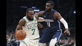 Boston Celtics guard Jaylen Brown (7) drives to the basket against Dallas Mavericks guard Tim Hardaway Jr. (11) during the first quarter of an NBA basketball game in Boston, Monday, Nov. 11, 2019. (AP Photo/Charles Krupa)