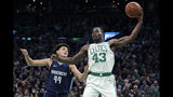 Boston Celtics guard Javonte Green (43) grabs a rebound against Dallas Mavericks forward Justin Jackson (44) during the first quarter of an NBA basketball game in Boston, Monday, Nov. 11, 2019. (AP Photo/Charles Krupa)