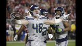 Seattle Seahawks tight end Jacob Hollister (48) celebrates after scoring against the San Francisco 49ers during the second half of an NFL football game in Santa Clara, Calif., Monday, Nov. 11, 2019. (AP Photo/Ben Margot)