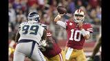 San Francisco 49ers quarterback Jimmy Garoppolo (10) passes against Seattle Seahawks defensive tackle Quinton Jefferson (99) during the second half of an NFL football game in Santa Clara, Calif., Monday, Nov. 11, 2019. (AP Photo/Tony Avelar)