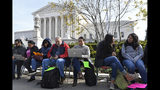 People wait in line outside the Supreme Court in Washington, Monday, Nov. 11, 2019, to be able to attend oral arguments in the case of President Donald Trump's decision to end the Obama-era, Deferred Action for Childhood Arrivals program (DACA). (AP Photo/Susan Walsh)