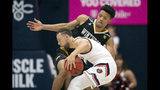Saint Mary's guard Jordan Ford, foreground, is defended by Winthrop guard Micheal Anumba during the second half of an NCAA college basketball game, Monday, Nov. 11, 2019 in Moraga, Calif. Winthrop upset 18th-ranked Saint Mary's 61-59. (AP Photo/D. Ross Cameron)