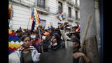 "Supporters of Bolivia's former President Evo Morales, with ""wiphala"" flags that represent the nation's indigenous people, protest outside Congress in La Paz, Bolivia, Tuesday, Nov. 12, 2019. Former President Evo Morales, who transformed Bolivia as its first indigenous president, flew to exile in Mexico on Tuesday after weeks of violent protests, leaving behind a confused power vacuum in the Andean nation. (AP Photo/Natacha Pisarenko)"