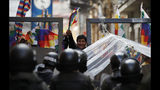 Police block supporters of former President Evo Morales from entering the area of Congress in La Paz, Bolivia, Tuesday, Nov. 12, 2019. Morales, who transformed Bolivia as its first indigenous president, flew to exile in Mexico on Tuesday after weeks of violent protests, leaving behind a confused power vacuum in the Andean nation. (AP Photo/Natacha Pisarenko)