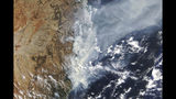 This Nov. 11, 2019, satellite photo taken by NASA shows the weather condition as bushfires burn in the eastern part of New South Wales state. Ferocious wildfires are burning at emergency-level intensity across Australia's most populous state and into Sydney suburbs as authorities warned most populations in their paths that there was no longer time to flee.(NASA via AP)