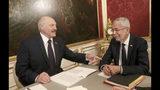 Belarusian President Alexander Lukashenko, left, talks with Austrian President Alexander Van der Bellen, right, during their meeting in Vienna, Austria, Tuesday, Nov. 12, 2019. (AP Photo/Ronald Zak)