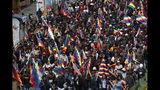 "Supporters of former President Evo Morales carry ""wiphala"" flags that represent indigenous peoples, as they march in La Paz, Bolivia, Tuesday, Nov. 12, 2019. Former President Evo Morales, who transformed Bolivia as its first indigenous president, flew to exile in Mexico on Tuesday after weeks of violent protests, leaving behind a confused power vacuum in the Andean nation. (AP Photo/Juan Karita)"