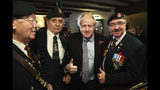 Britain' Prime Minister Boris Johnson, centre, meets with military veterans at the Lych Gate Tavern in Wolverhampton, England, Monday, Nov. 11, 2019 as part of the General Election campaign trail. Britain goes to the polls on Dec. 12. (Stefan Rousseau/PA via AP)