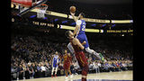 Philadelphia 76ers' Ben Simmons, right, fouls Cleveland Cavaliers' Kevin Love as he goes up for a shot during the first half of an NBA basketball game, Tuesday, Nov. 12, 2019, in Philadelphia. (AP Photo/Matt Slocum)