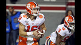 Clemson's Trevor Lawrence (16) looks to throw the ball during the first half of an NCAA college football game against North Carolina State in Raleigh, N.C., Saturday, Nov. 9, 2019. (AP Photo/Karl B DeBlaker)