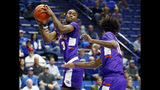 Evansville's Jawaun Newton (3) pulls down a rebound near teammate DeAndre Williams during the first half of an NCAA college basketball game against Kentucky in Lexington, Ky., Tuesday, Nov. 12, 2019. (AP Photo/James Crisp)