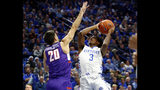 Kentucky's Tyrese Maxey (3) shoots while defended by Evansville's Sam Cunliffe (20) during the first half of an NCAA college basketball game in Lexington, Ky., Tuesday, Nov. 12, 2019. (AP Photo/James Crisp)
