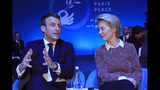 European Commission president Ursula von der Leyen listens to French President Emmanuel Macron at the start of the Paris Peace Forum Tuesday, Nov. 12, 2019 in Paris. (AP Photo/Michel Euler, Pool)