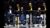 Former San Antonio Spurs guard Tony Parker, right, sits with former teammates Tim Duncan, left, and Manu Ginobili, center, during Parker's retirement ceremony after the team's NBA basketball game against the Memphis Grizzlies in San Antonio, Monday, Nov. 11, 2019. (AP Photo/Eric Gay)