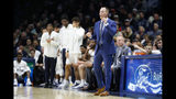 Xavier coach Travis Steele stands near the bench during the first half of the team's NCAA college basketball game against Missouri, Tuesday, Nov. 12, 2019, in Cincinnati. (AP Photo/John Minchillo)