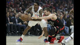 Los Angeles Clippers guard Lou Williams, left, vies for a loose ball with Toronto Raptors center Marc Gasol during the first half of an NBA basketball game in Los Angeles, Monday, Nov. 11, 2019. (AP Photo/Chris Carlson)
