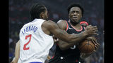 Toronto Raptors forward OG Anunoby, right, reacts after getting hit in the eye by Los Angeles Clippers forward Kawhi Leonard during the first half of an NBA basketball game in Los Angeles, Monday, Nov. 11, 2019. (AP Photo/Chris Carlson)