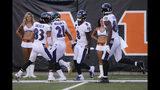 Baltimore Ravens quarterback Lamar Jackson (8) celebrates his touchdown during the second half of NFL football game against the Cincinnati Bengals, Sunday, Nov. 10, 2019, in Cincinnati. (AP Photo/Gary Landers)
