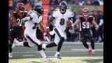 Baltimore Ravens quarterback Lamar Jackson (8) runs the ball for a touchdown during the second half of NFL football game against the Cincinnati Bengals, Sunday, Nov. 10, 2019, in Cincinnati. (AP Photo/Gary Landers)