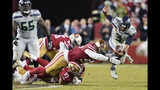 Seattle Seahawks quarterback Russell Wilson (3) scrambles away from San Francisco 49ers defenders during overtime of an NFL football game in Santa Clara, Calif., Monday, Nov. 11, 2019. Wilson was ruled sacked on the play. (AP Photo/Tony Avelar)