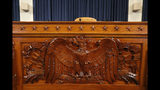 The dais inside the hearing room where the House will begin public impeachment hearings Wednesday, is seen Tuesday, Nov. 12, 2019, on Capitol Hill in Washington. With the bang of a gavel, House Intelligence Committee Chairman Adam Schiff will open the hearings into Trump's pressure on Ukraine to investigate Democratic rival Joe Biden's family. (AP Photo/Jacquelyn Martin)