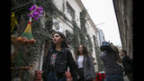 """A television crew work as people walk near the house of former British army officer James Le Mesurier who helped found the """"White Helmets"""" volunteer organization in Syria, in Istanbul, Monday, Nov. 11, 2019. Turkish officials and news reports said Monday that Le Mesurier's body was found near his home in Istanbul's Beyoglu district by worshippers on their way to a mosque to pray. (AP Photo/Emrah Gurel)"""