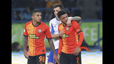 Shakhtar's Brazilian player Taison, right, reacts as he leaves the pitch after he was red-carded for his reaction on racial abuse, while Dynamo Kyiv Mykola Shaparenko, center, calmed him down, during Premier League soccer match in Kharkiv, Ukraine, on Sunday, Nov. 10, 2019. Shakhtar's Dodo, left, looks on. The Ukrainian Premier League on Monday called for an inquiry after a Brazilian player for Shakhtar Donetsk was sent off for responding to racist abuse with an obscene gesture. (AP Photo/Oleksandr Osipov)