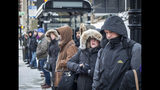 "Commuters wait for a buses outside Union Station on Tuesday, Nov. 12, 2019, in Chicago. The National Weather Service said Tuesday and Wednesday may see record cold from the southern Plains to the Mississippi Valley to the Great Lakes and beyond, thanks to what it calls an ""arctic airmass"" that started in Siberia and has been spilling over a big chunk of the Midwest and East Coast. (Rich Hein/Chicago Sun-Times via AP)"